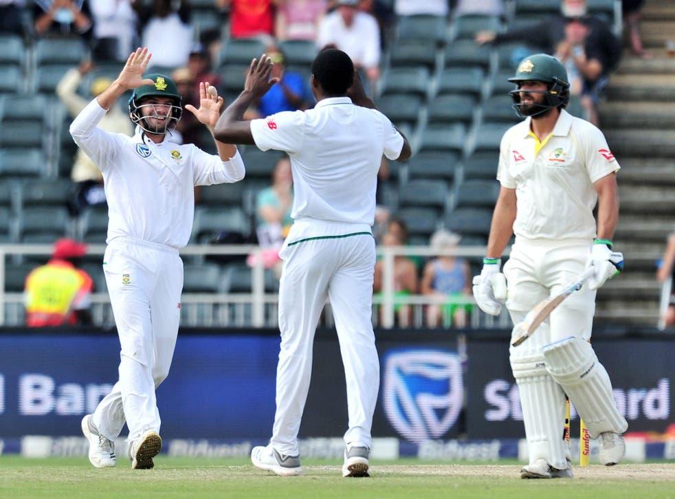Kagiso Rabada celebrates with Aiden Markram after taking the wicket of Joe Burns