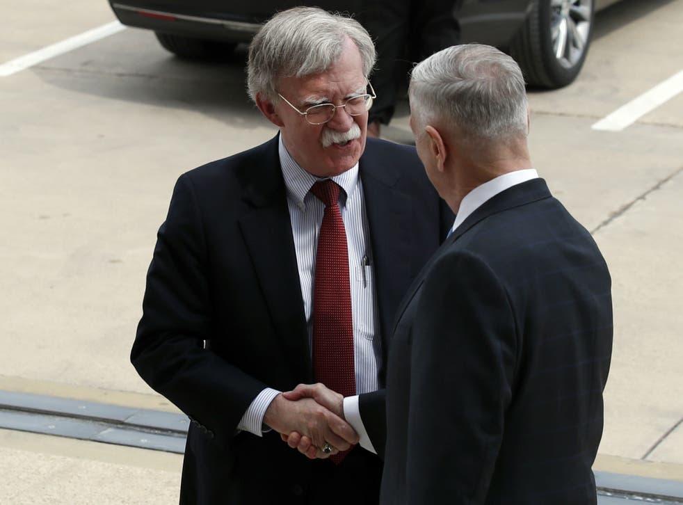John Bolton shakes hands with Defense Secretary Jim Mattis as Bolton arrives at the Pentagon