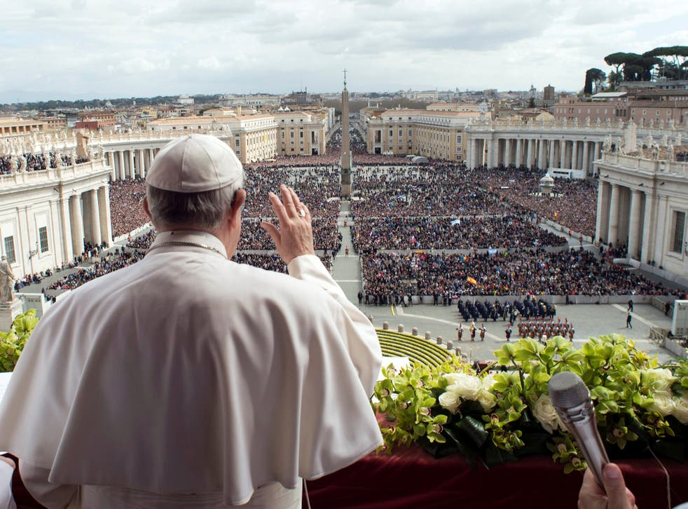 Pope Francis appears before the crowd in St Peter's Square on Easter Sunday