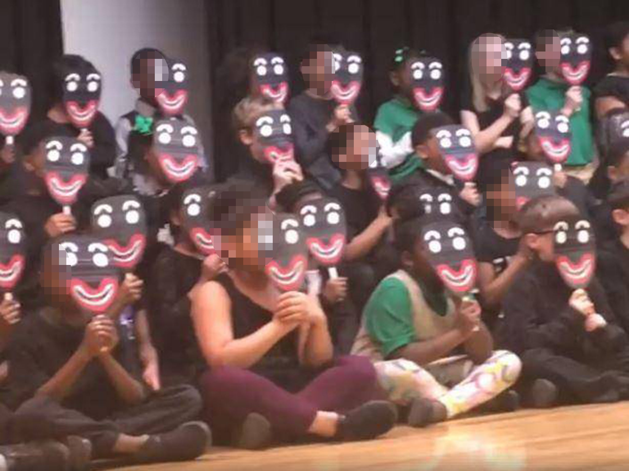 School apologises after children perform Black History Month poem in blackface masks