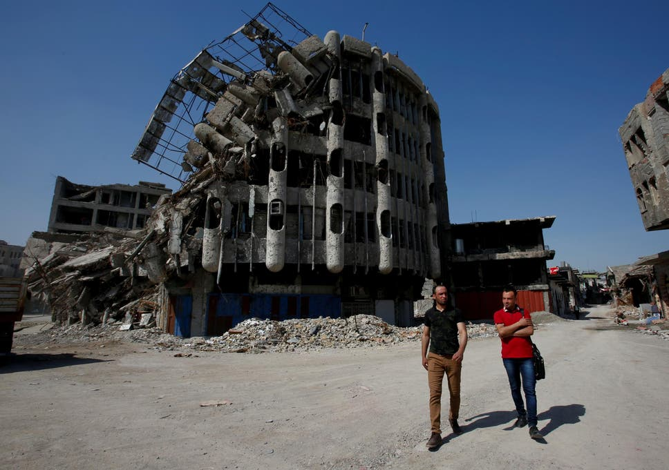 A damaged building in Mosul testifies to the violence that was
