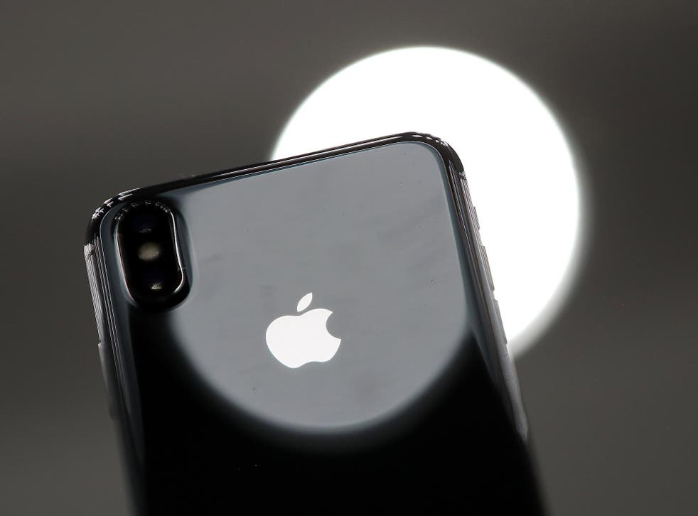 The new iPhone X is displayed during an Apple special event at the Steve Jobs Theatre on the Apple Park campus on September 12, 2017 in Cupertino, California