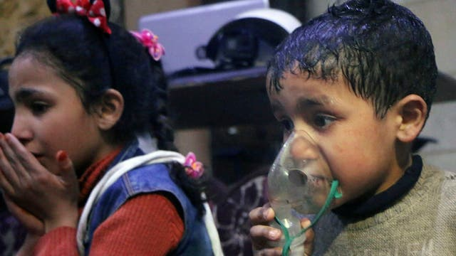 A child receiving oxygen through respirators following an alleged poison gas attack in the rebel-held town of Douma