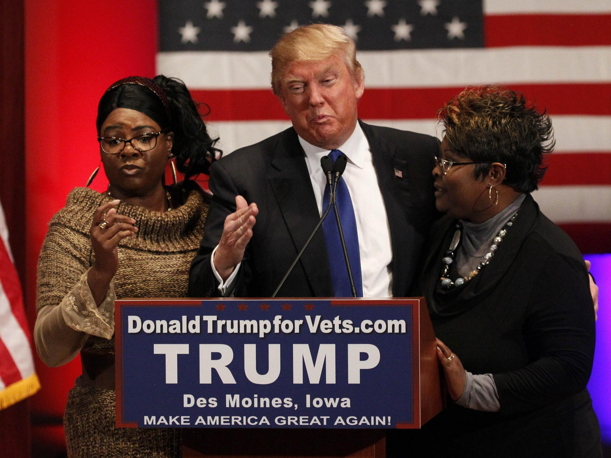 'I love Diamond and Silk': Trump stands by controversial sisters 'fired' by Fox over conspiracy theories photo