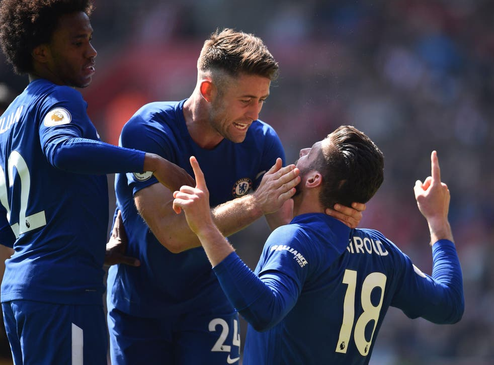 Olivier Giroud is embraced after scoring his winning goal