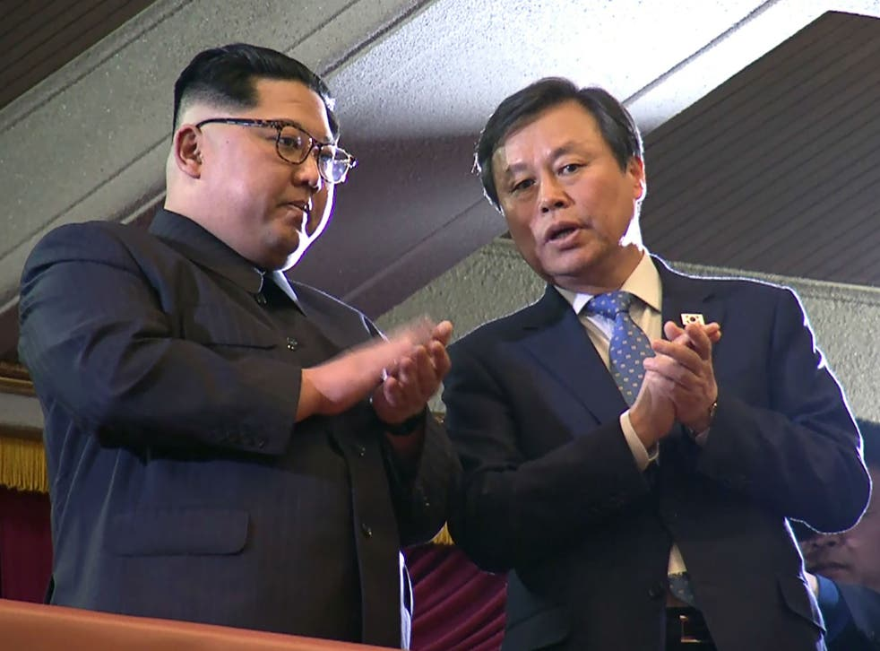 North Korean leader Kim Jong-un and South Korea's Culture, Sports and Tourism Minister Do Jong-whan during a rare concert by South Korean musicians in Pyongyang, North Korea