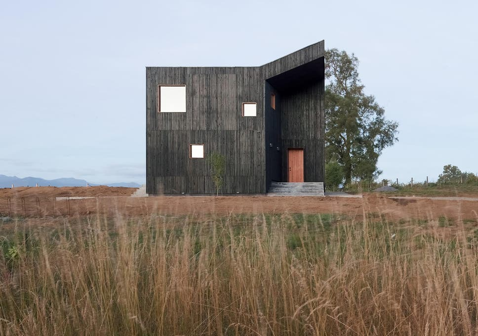 3abe114d23 Inspiring home of the week: Timber retreat tucked away in the shadow of a  Chilean volcano