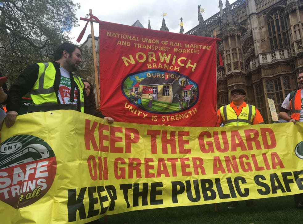 Strike call: Members of the RMT union who work for Greater Anglia demonstrating outside Parliament