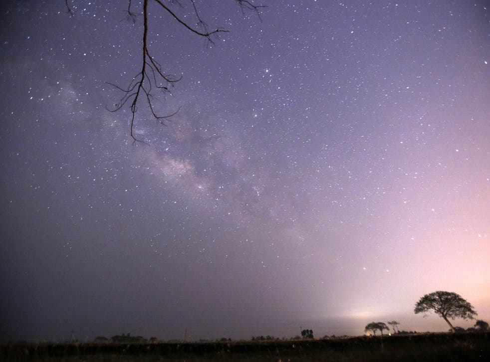 This long-exposure photograph taken on April 23, 2015 on Earth Day shows Lyrids meteors shower passing near the Milky Way in the clear night sky of Thanlyin, nearly 14miles away from Yangon