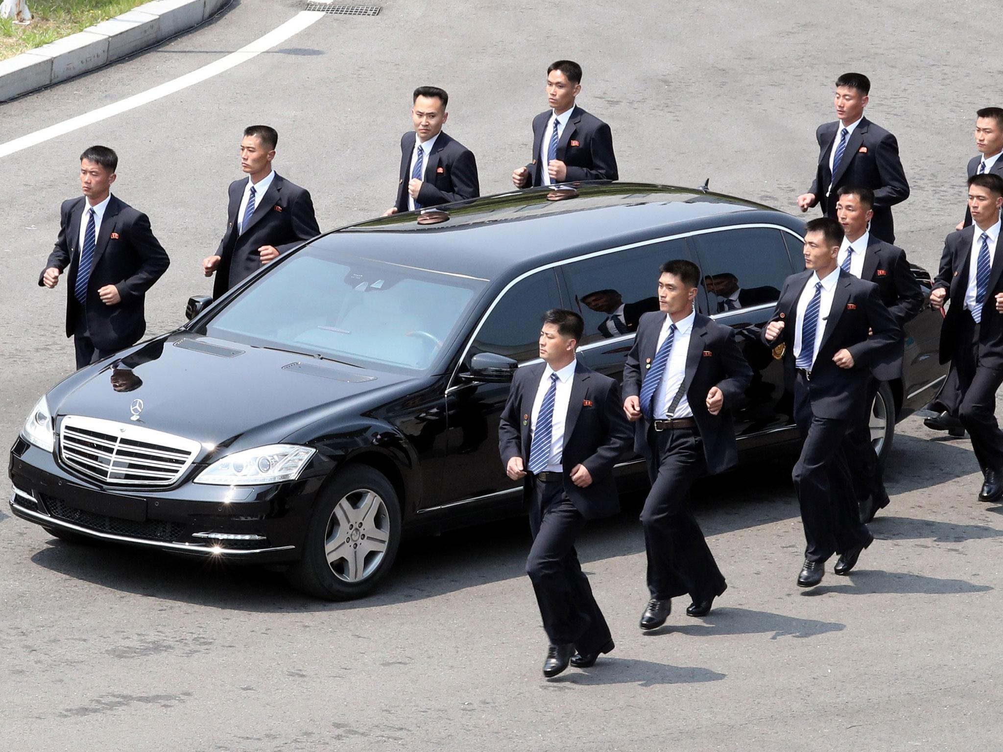 kim jong un 39 s official car flanked by 12 bodyguards running in formation the independent. Black Bedroom Furniture Sets. Home Design Ideas
