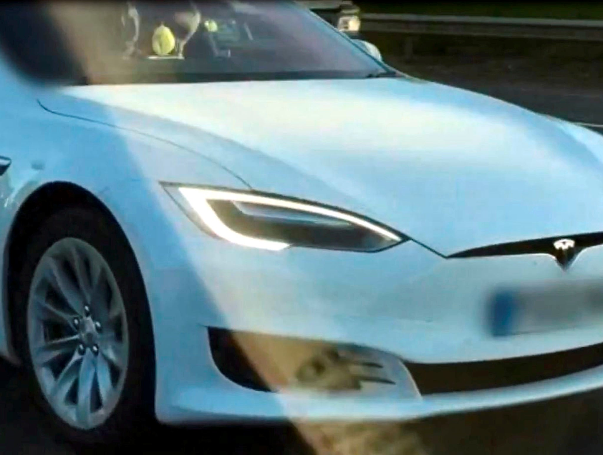 Tesla driver caught turning on autopilot and leaving