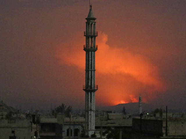 Smoke rises after military points of the 47th regiment of the Assad regime were hit in Hama