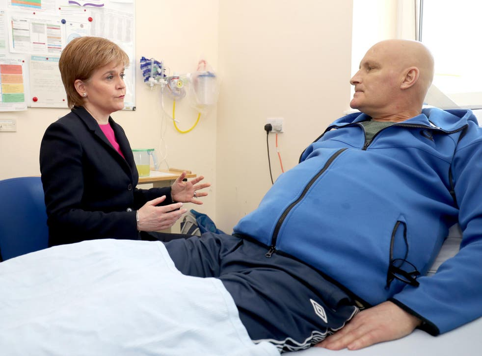 Scottish First Minister Nicola Sturgeon meets patient Thomas Crawford during a visit to the Edinburgh Royal Infirmary, as she marks the minimum unit pricing for alcohol coming into force