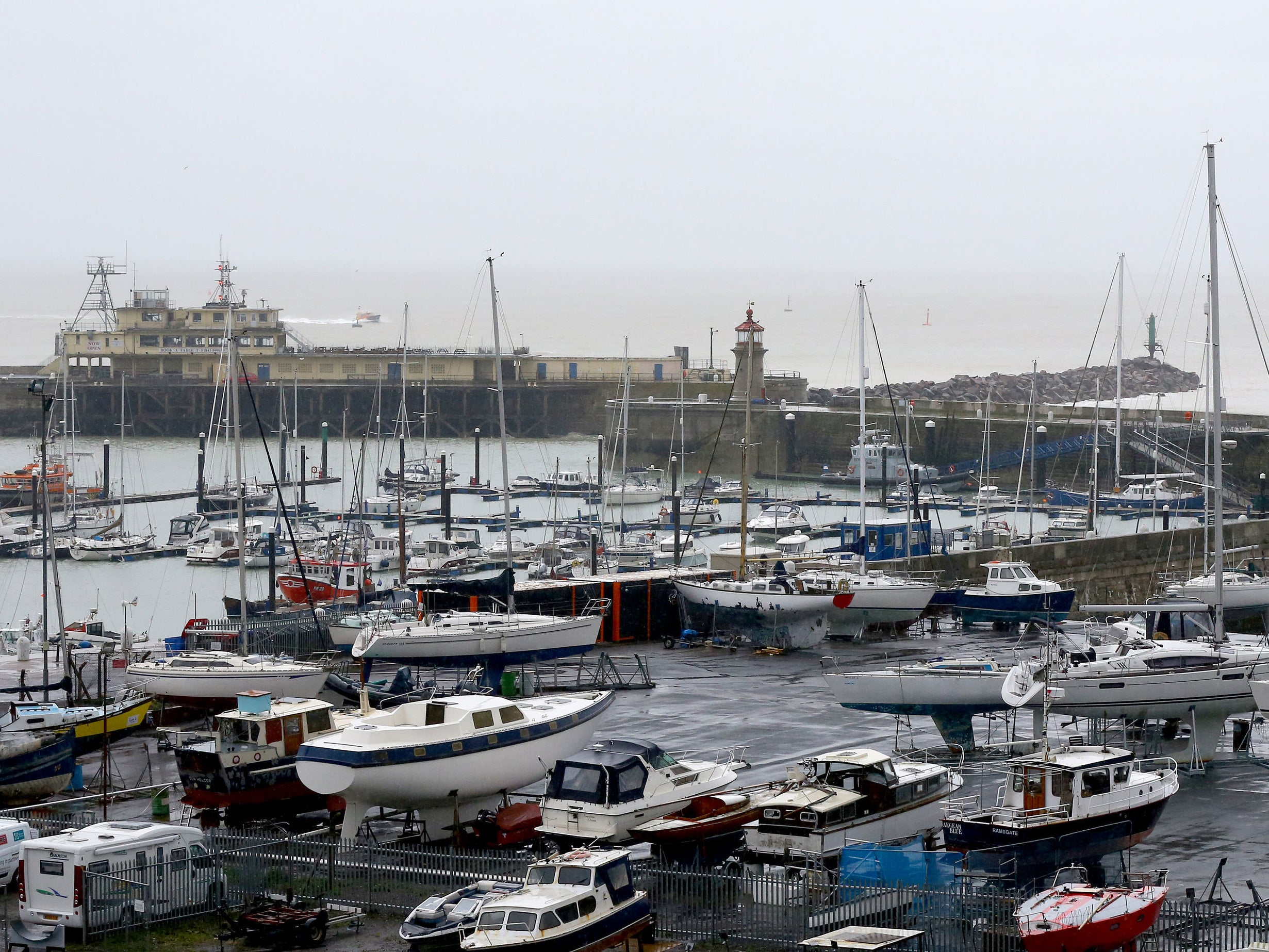 UK weather: Man dies after being swept into harbour as heavy rain and wind lash UK | The Independentindependent_brand_ident_LOGOUntitled