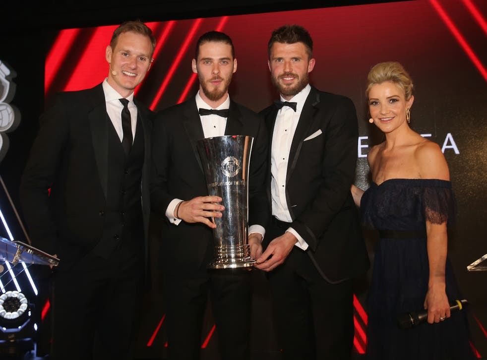 David de Gea collecting his trophy from team-mate Michael Carrick