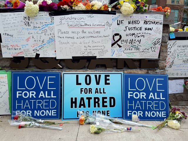 <p>Signs show support for victims of the 2018 Toronto van attack.</p>