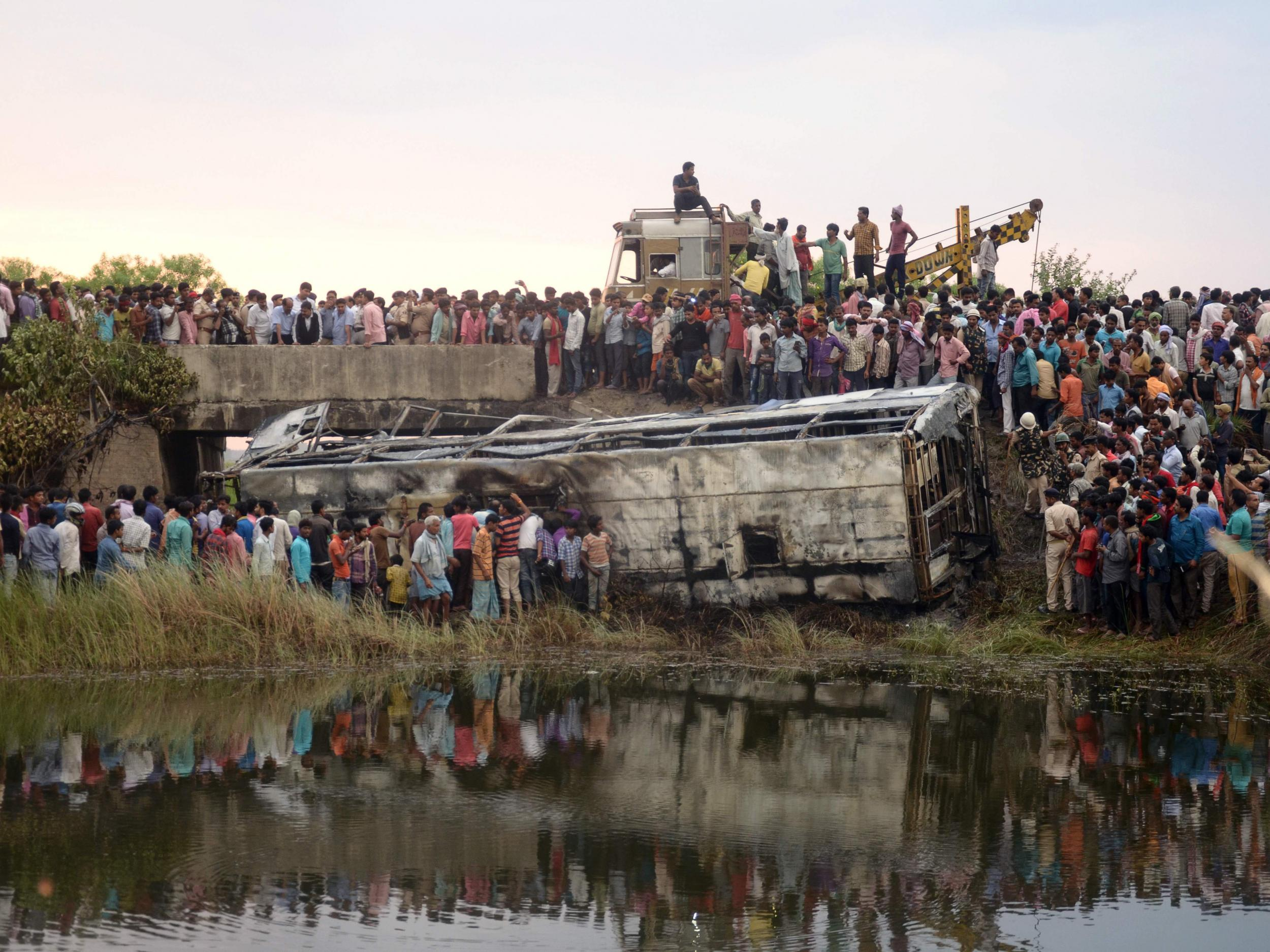 Dozens killed after bus plunges off Indian mountain