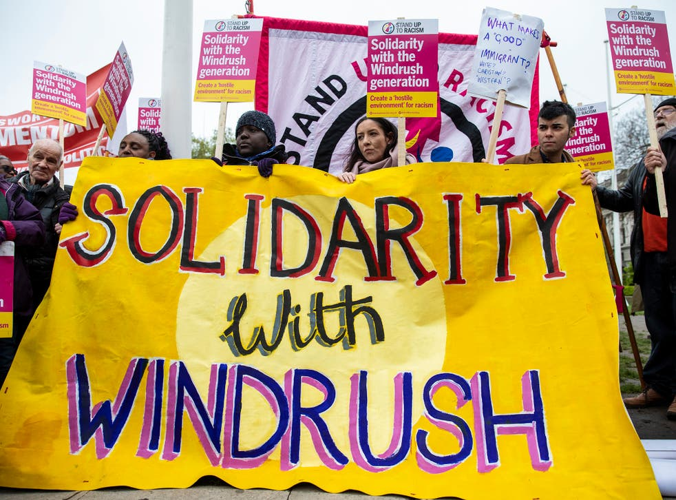 Protesters gather in Parliament Square to demonstrate about the ongoing Windrush migrant scandal