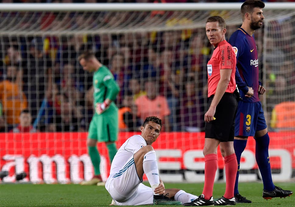 3ce3c40af9e Cristiano Ronaldo will undergo tests on an ankle strain suffered in Real  Madrid s 2-2