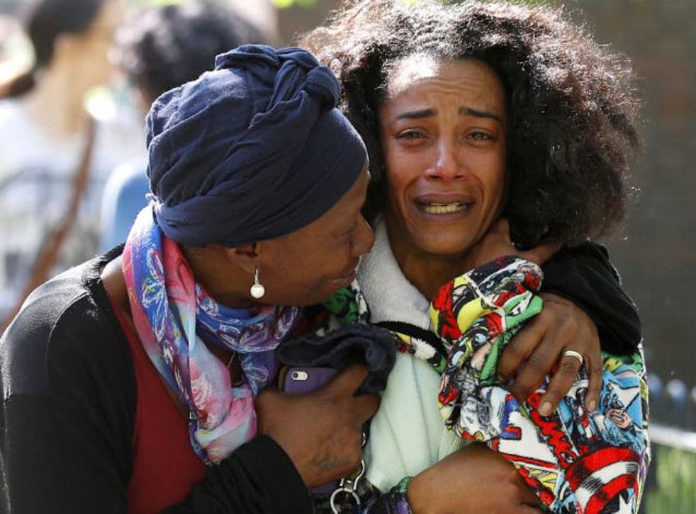 Pretana Morgan (right) is comforted as she grieves for her son Rhyhiem Ainsworth Barton, who was shot dead aged 17