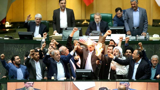 Iranian MPs burnt a US flag in parliament after Donald Trump announced America's withdrawal from the nuclear deal.