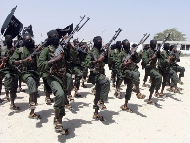 Hundreds of newly trained al-Shabab fighters perform military exercises in the Lafofe area some 18 km south of Mogadishu, in Somalia