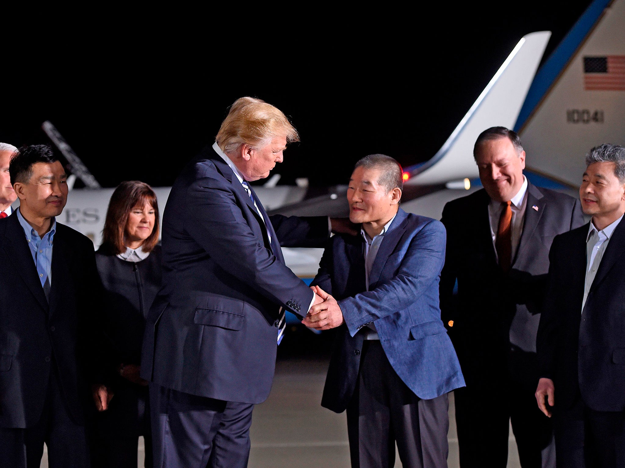 Donald Trump greets American hostages released by North Korea as they touch down on US soil