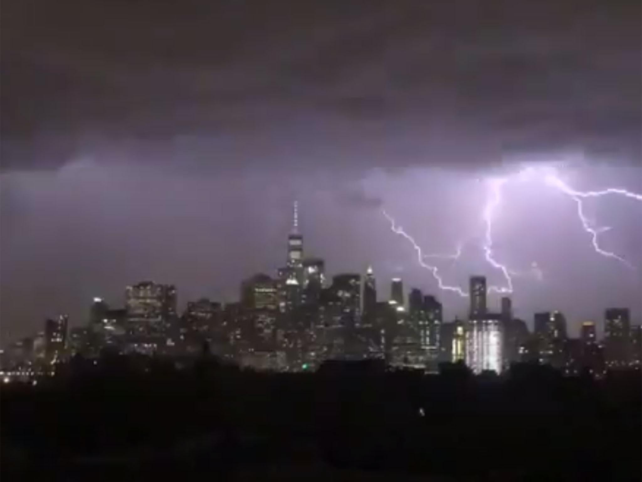 US weather latest: New York skyline lit up by forked lightning