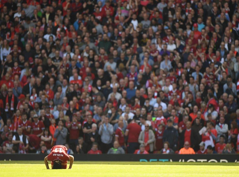 Mohamed Salah kisses the turf after scoring
