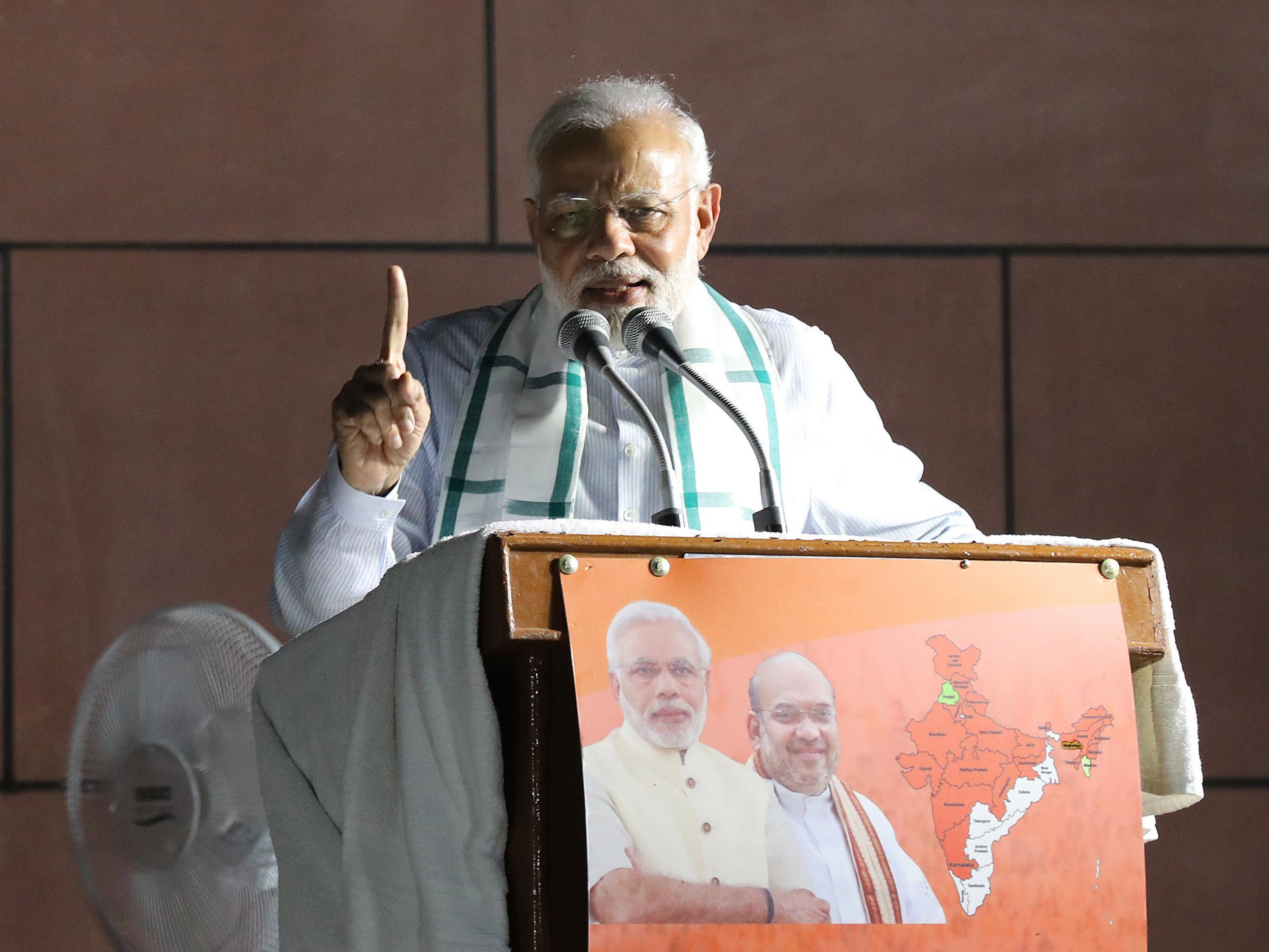 India election: Party of PM Narendra Modi wins emphatic victory in key state vote