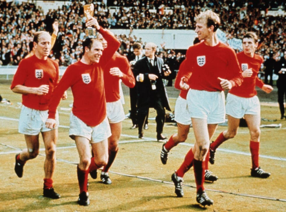 The Three Lions star (pictured holding trophy) celebrates with his teammates