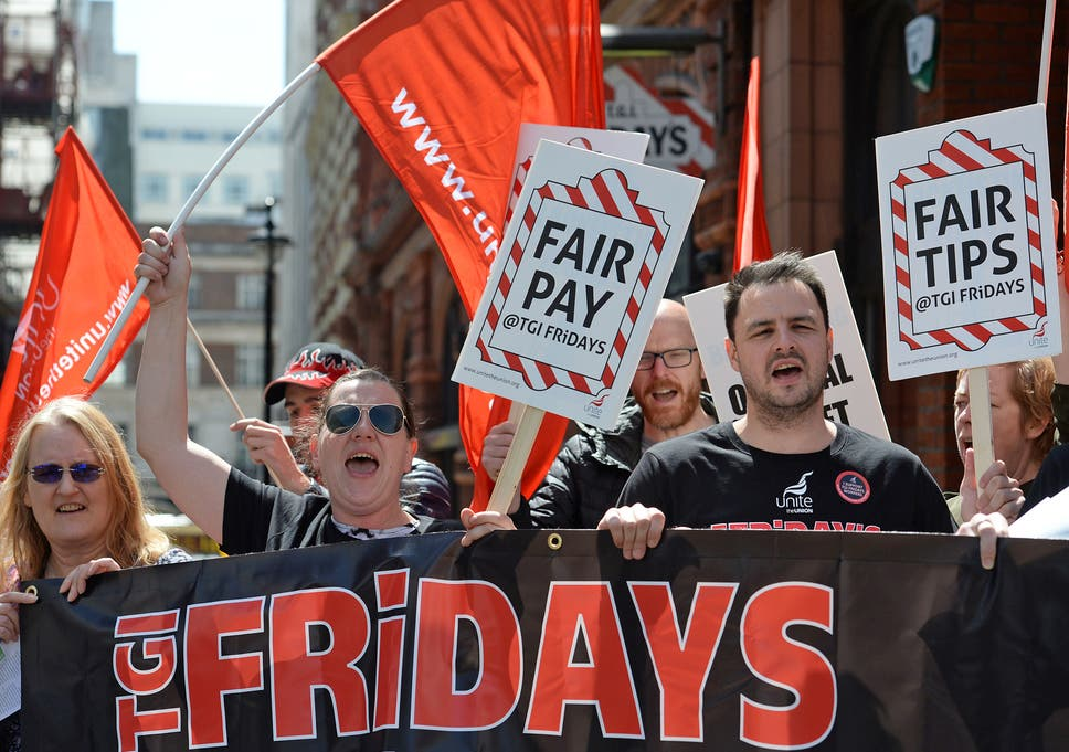 TGI Fridays workers strike over tips policy and low wages | The