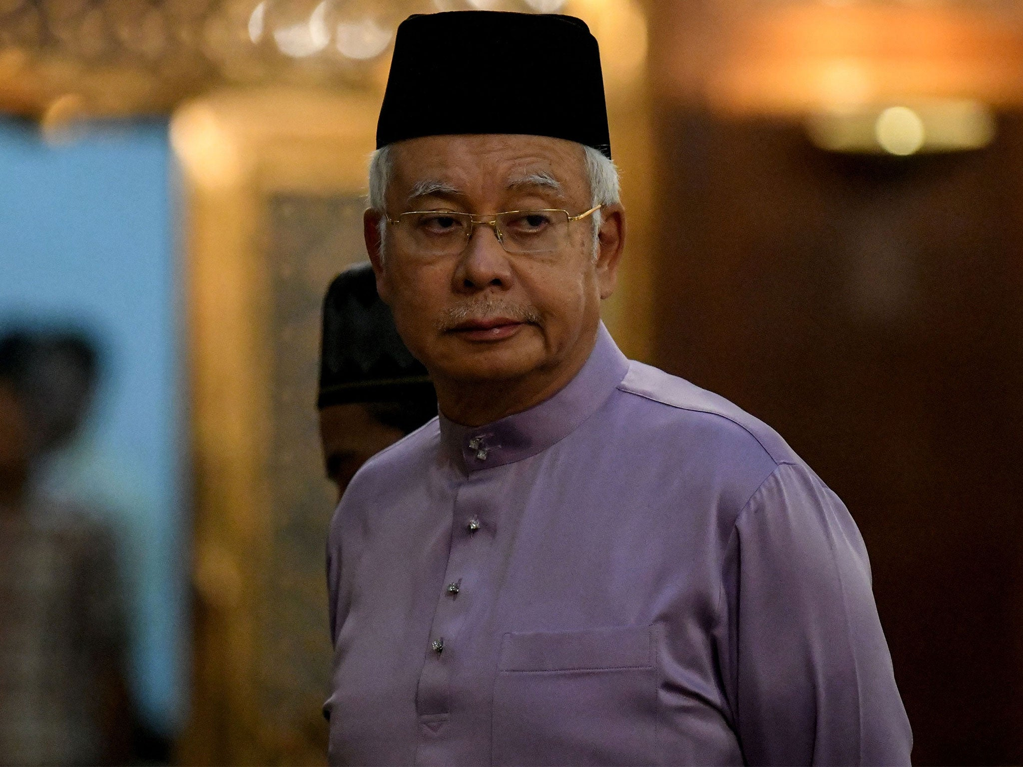 Former Malaysian PM angry as anti-corruption police raid his home and seize luxury items
