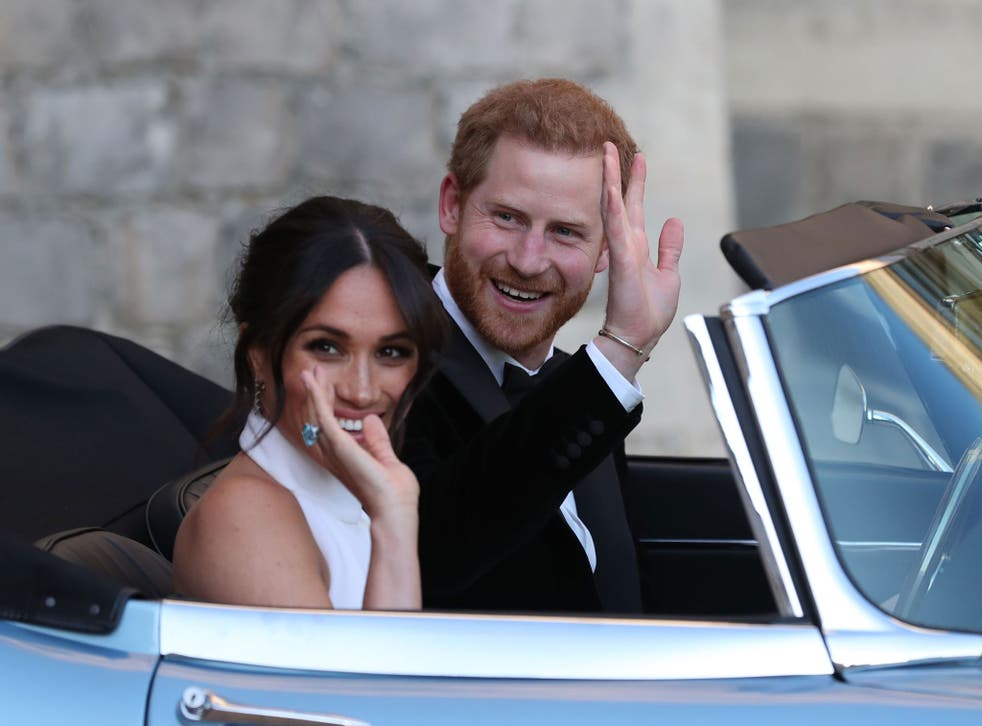 Harry and Meghan in an E-Type Jaguar after their wedding