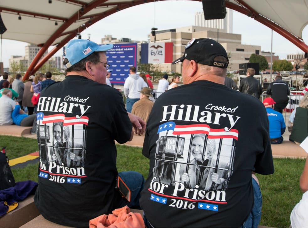 Supporters of then-presidential candidate Donald Trump chanted 'Lock her up' at a rally in Cedar Rapids, Iowa on 28 October 2016.