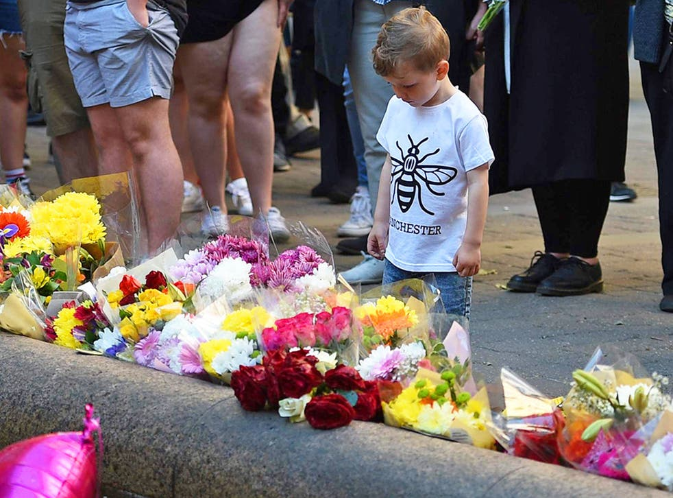 People paying their respects in central Manchester on the first anniversary of the attack