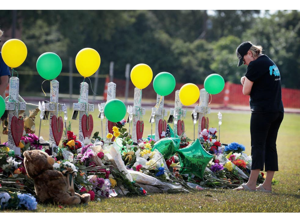 A memorial for the dead after the shooting in Santa Fe, Texas last week