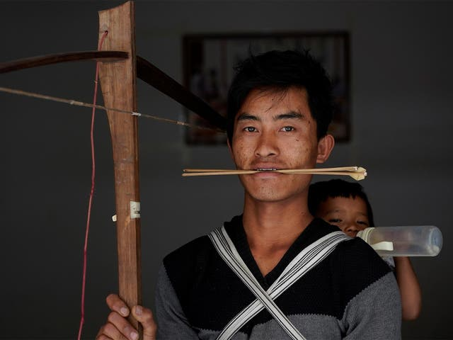 Secret weapons: Zhang and other tribe members are aiming to save the tradition, which dates back to 200BC, by promoting it as a sport