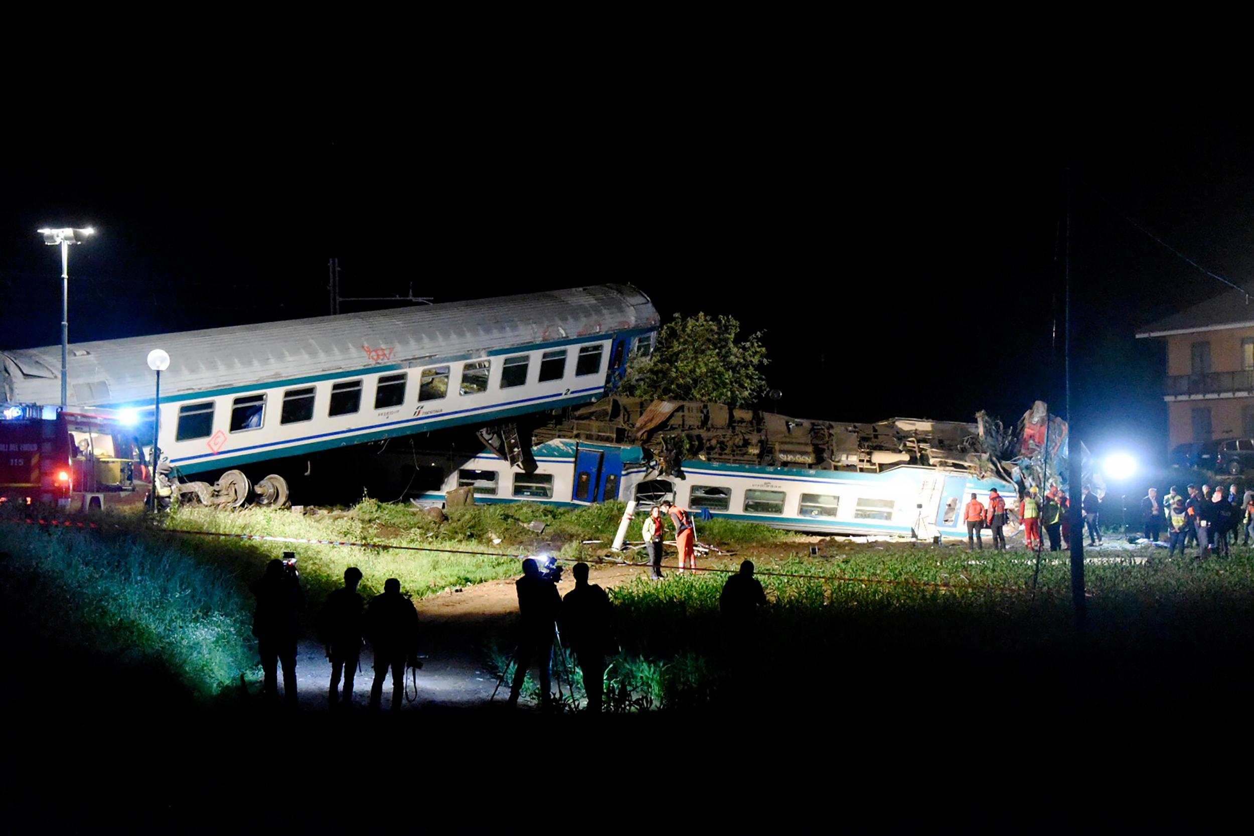 Italy train crash: At least two dead after train hits lorry and derails near Turin