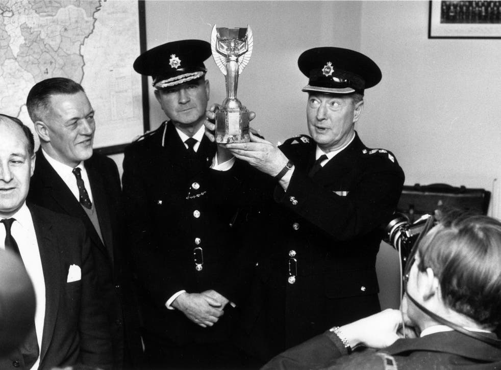 London police with the Jules Rimet trophy after it was found by Pickles the dog following its initial disappearance
