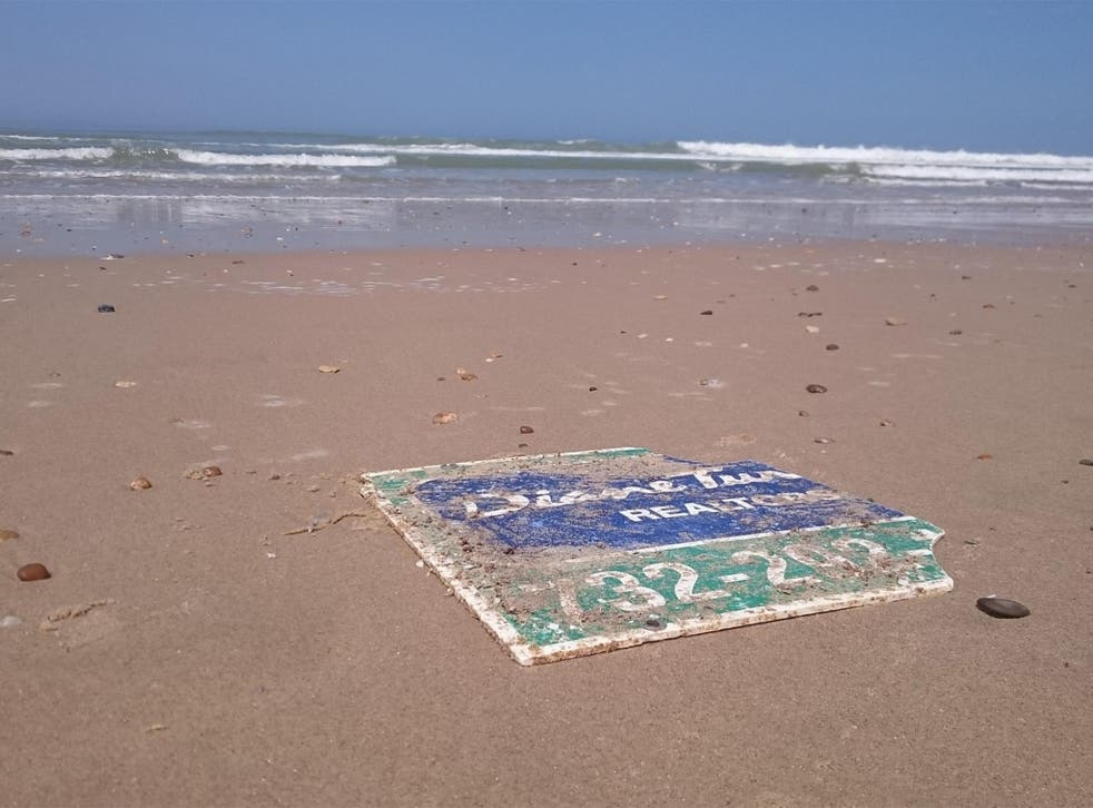 The sign washed up nearly 4,000 miles away from New Jersey