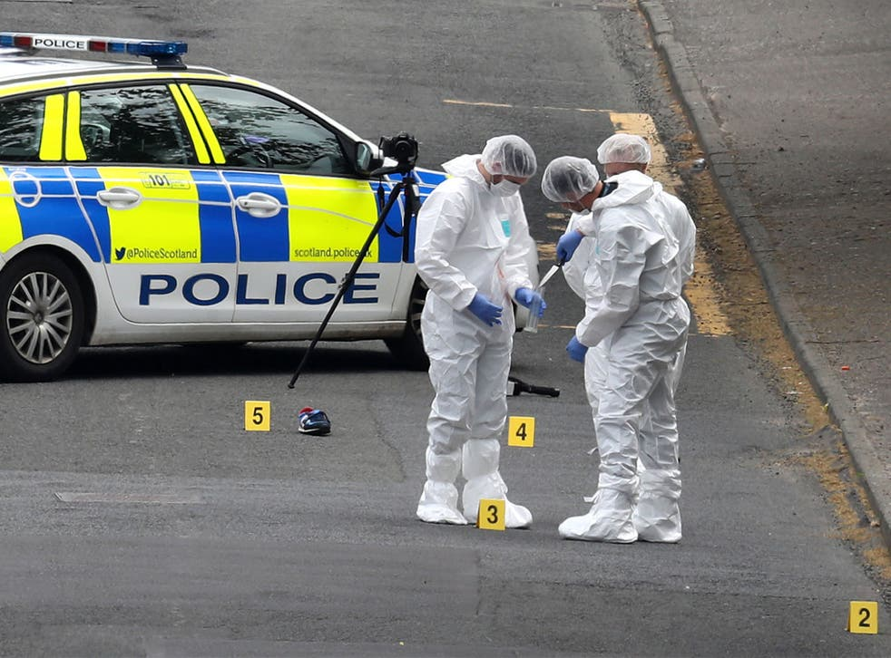 Forensics officers at the scene of the attack in Greenock on 1 June