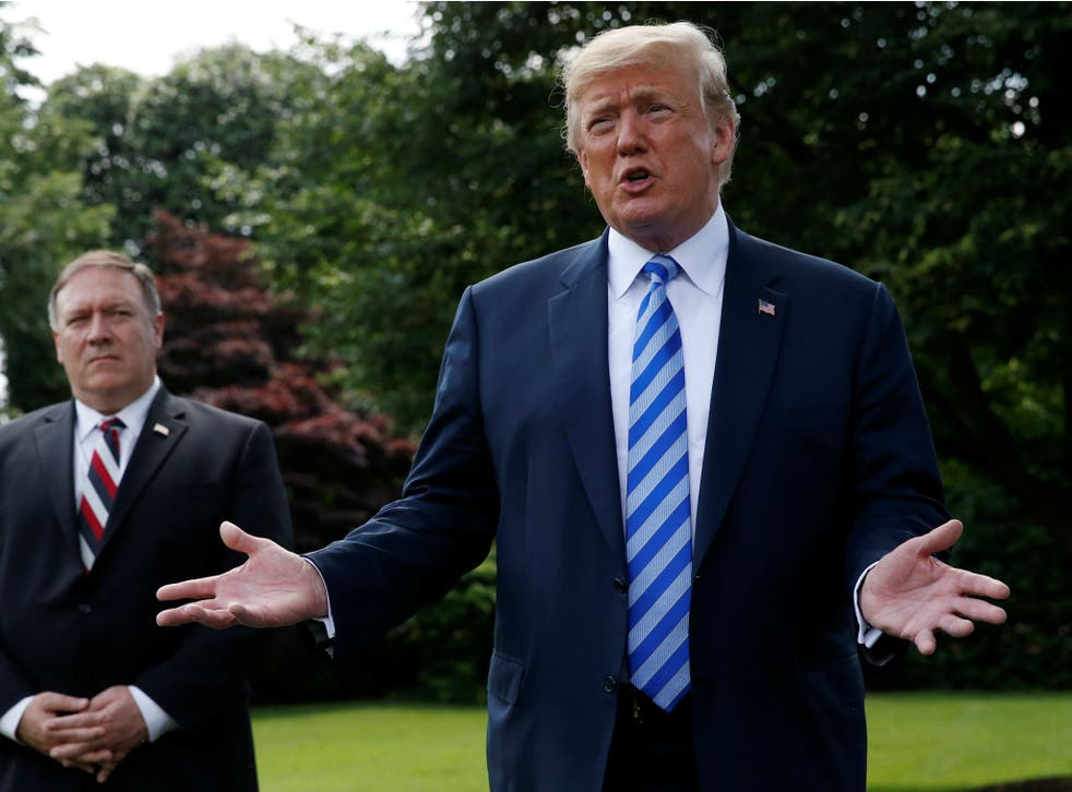 President Donald Trump talks with the media outside the White House as US Secretary of State Mike Pompeo looks on