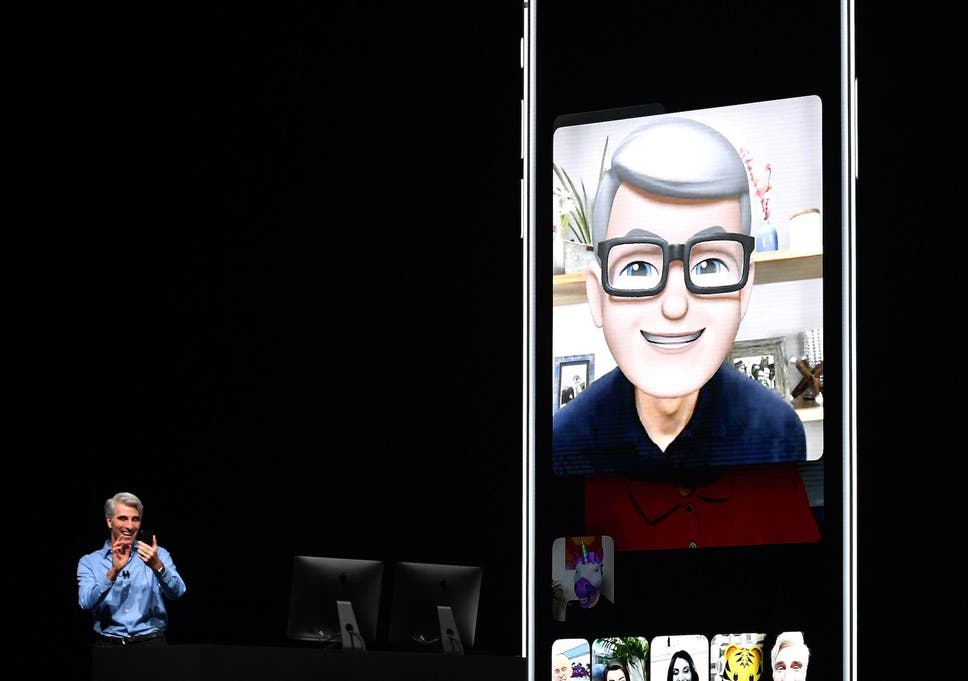 Apple CEO Tim Cook (L) speaks using his Memoji during a group FaceTime call on stage during Apple's Worldwide Developer Conference (WWDC) at the San Jose Convention Centerin San Jose, California