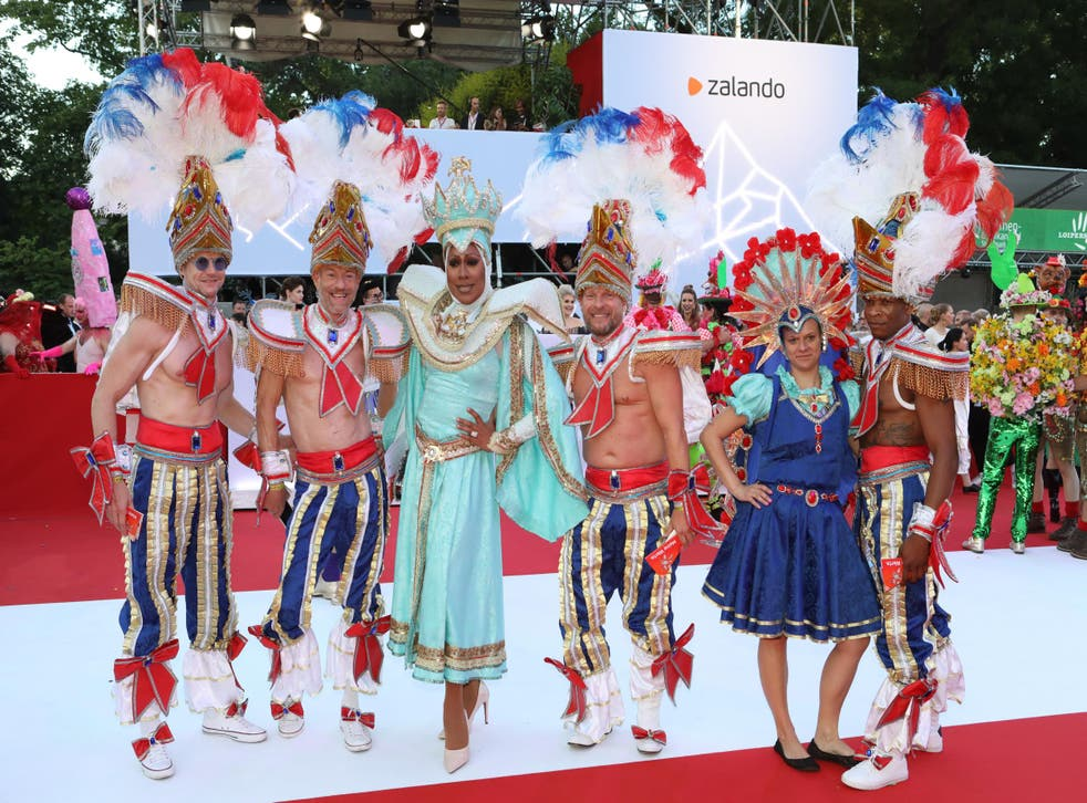 Drag performers pose on the red carpet at the Life Ball in Austria.