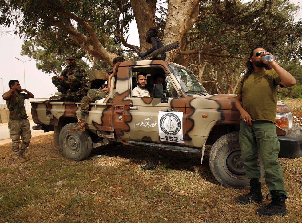 Libyan forces, loyal to Libyan strongman Khalifa Haftar, gather near the coastal city of Derna