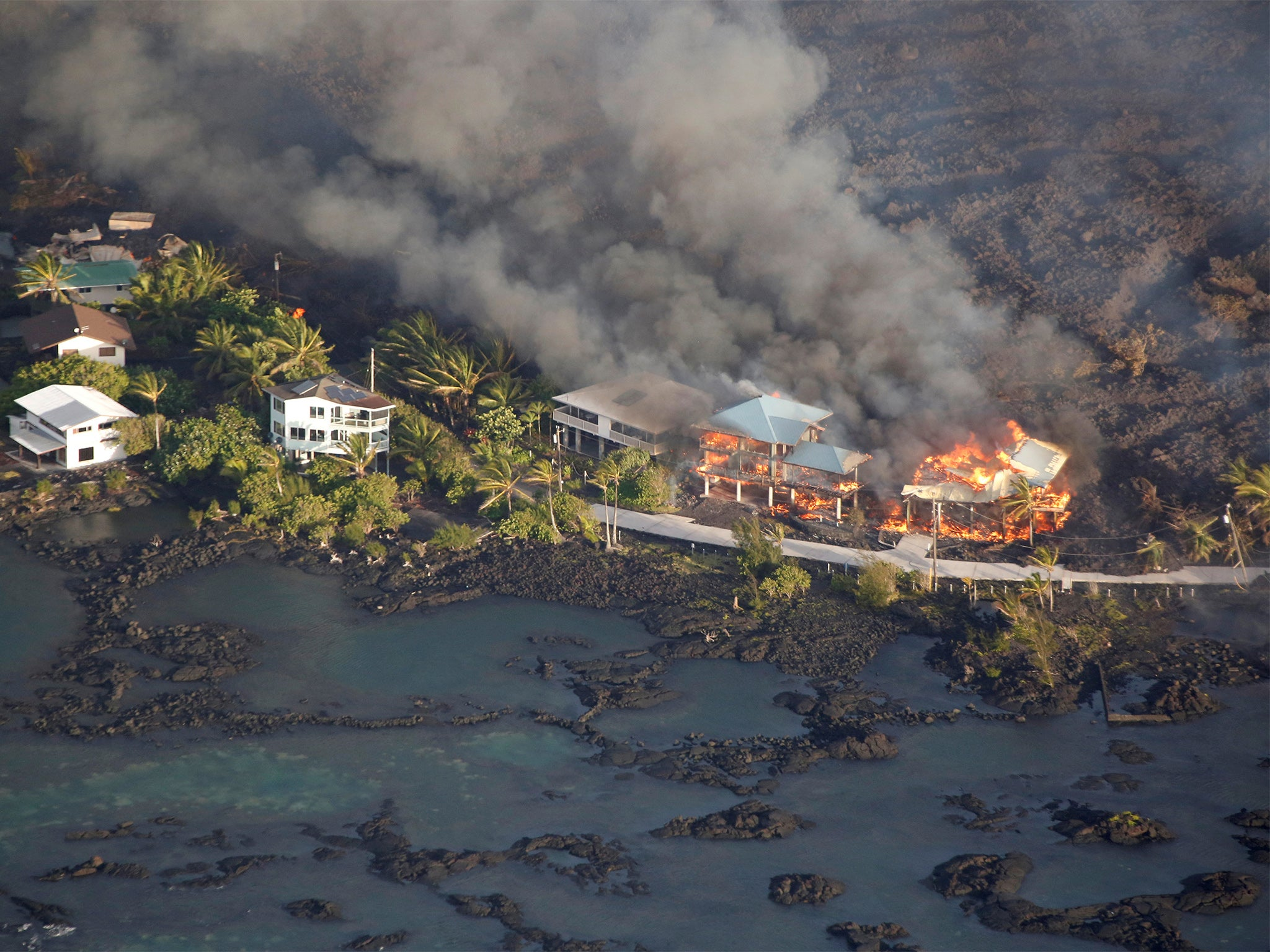 River of lava engulfs entire Hawaii neighbourhood and adds almost a mile of new land to shoreline