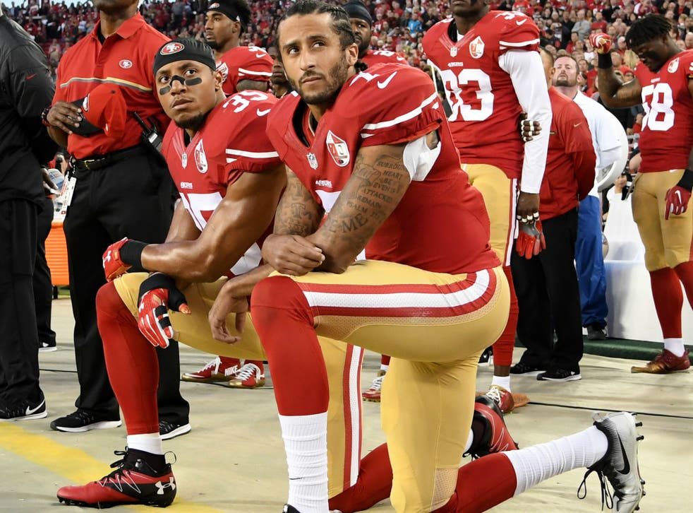 Colin Kaepernick (right) and Eric Reid of the San Francisco 49ers kneel in protest during the national anthem prior to an NFL game in Santa Clara, California