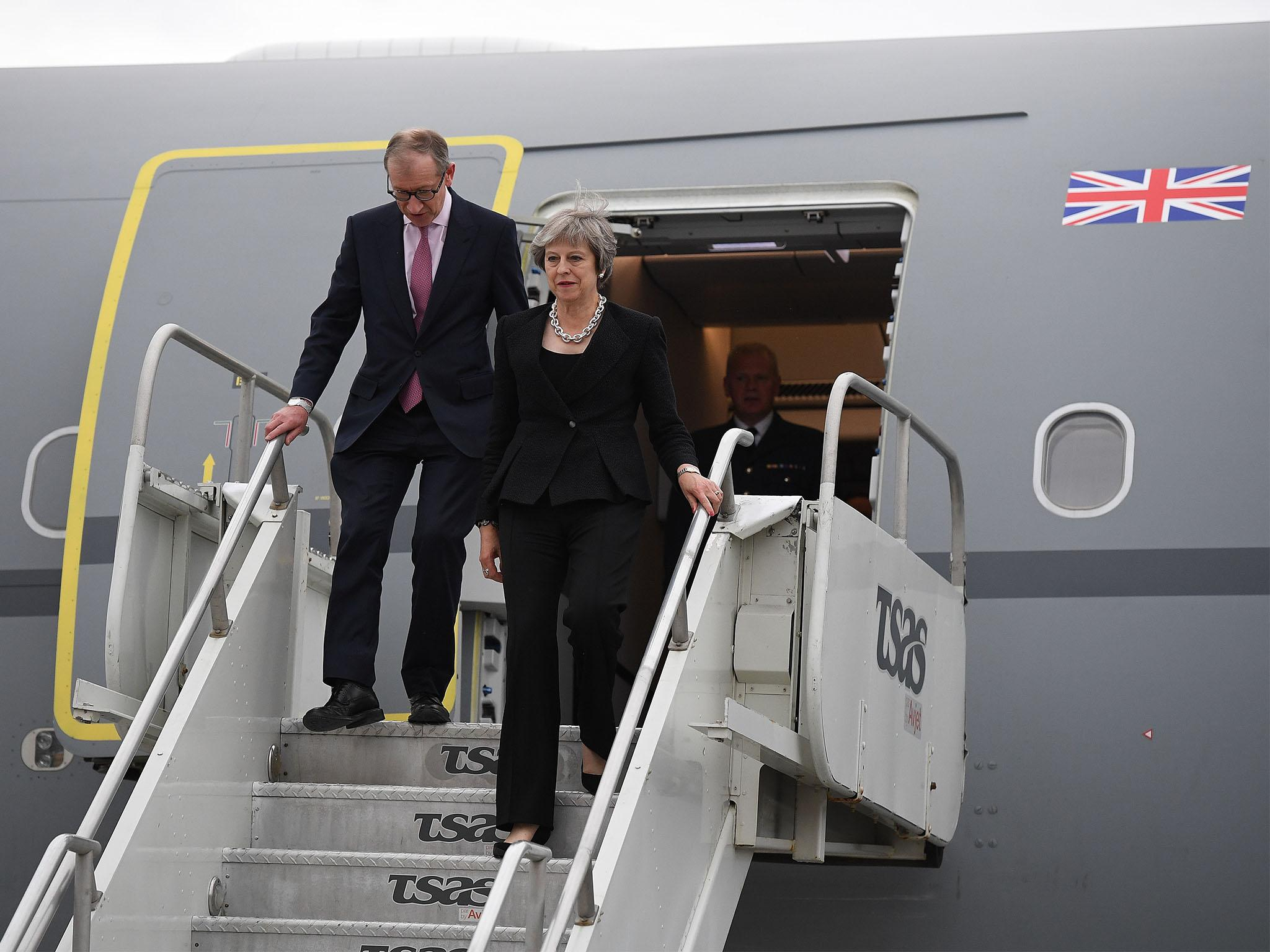 May defends Trump after he declines formal meeting at G7 summit
