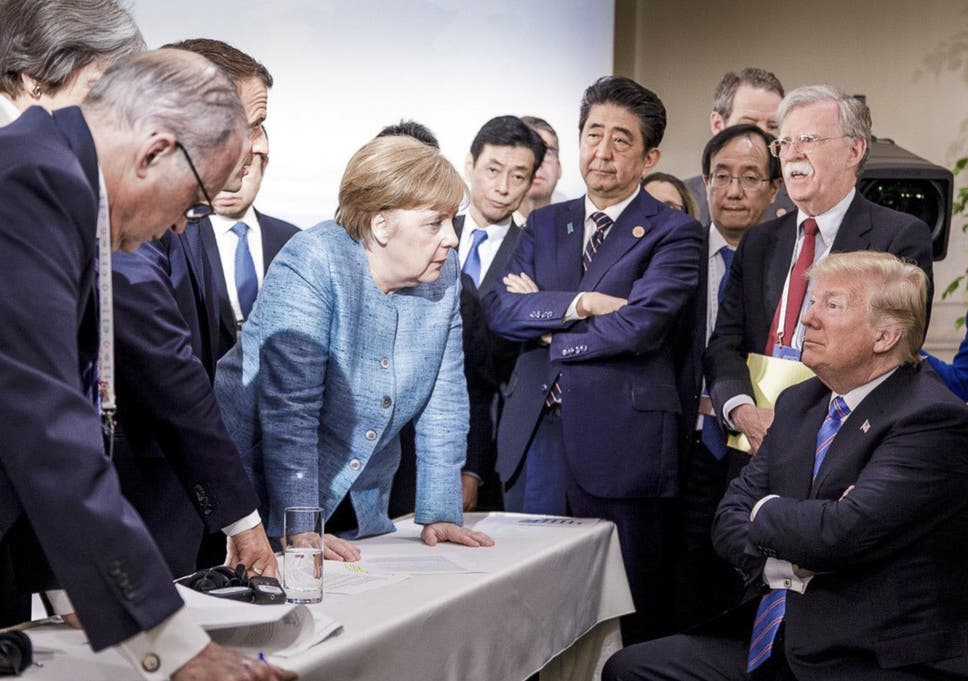 Image result for PHOTO OF MERKEL STARING DOWN tRUMP